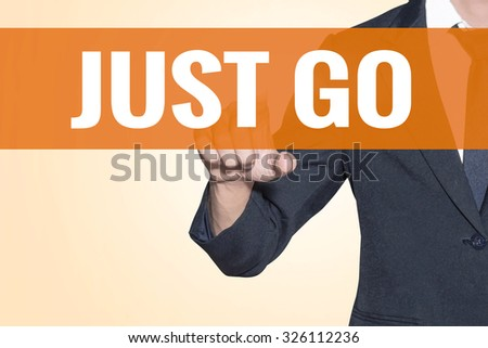 Business man Just Go word touch on virtual screen orange background - stock photo