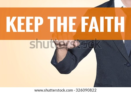 Business man Keep the Faith word touch on virtual screen orange background - stock photo