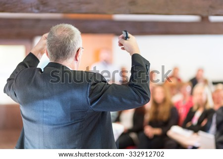 Business man leading a business workshop. Corporate executive delivering a presentation to his colleagues during meeting or in-house business training. Business and entrepreneurship concept. - stock photo