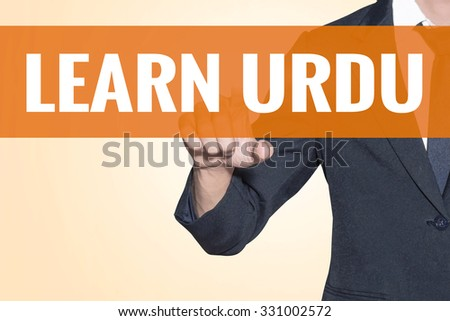 Business man Learn Urdu word touch on virtual screen orange background - stock photo