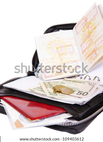 business man leather travel date book with money passport and boa - stock photo