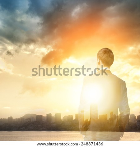 business man look at sunrise in the city - stock photo