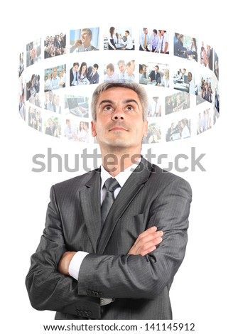 business man looking a virtual buttons - stock photo