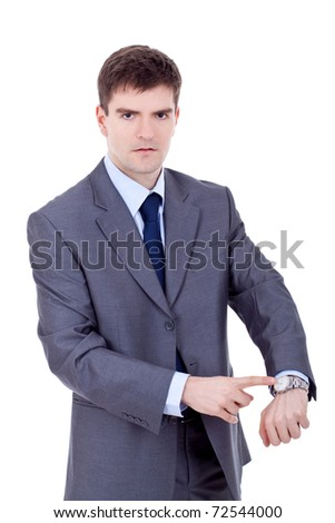 business man looking and pointing at his watch over white