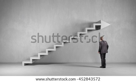 Business man looking at arrow shaped staircase on wall (3D Rendering)