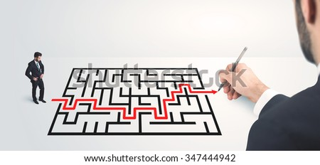 Business man looking at hand drawing solution, maze solution concept - stock photo