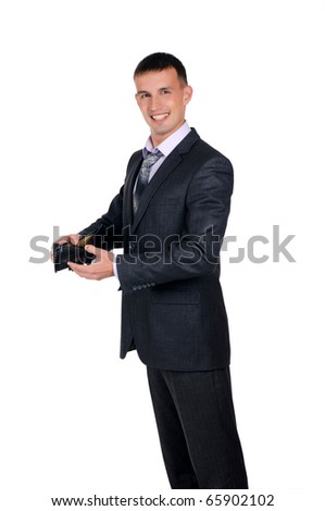 Business man looking at his empty wallet. Isolated on a white background