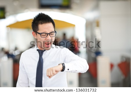 business man looking at watch - stock photo