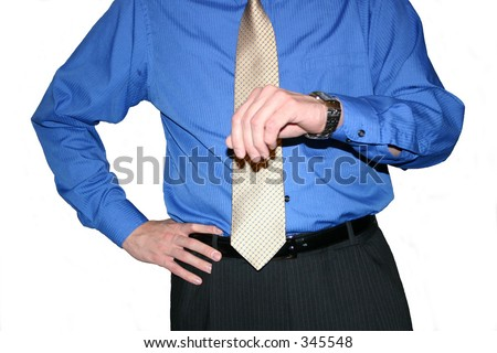 Business man looking at watch hand on hip