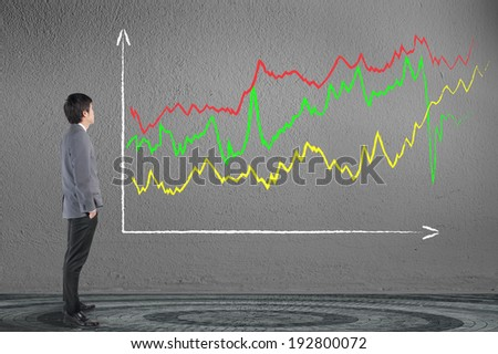 Business man looking financial business graph - stock photo