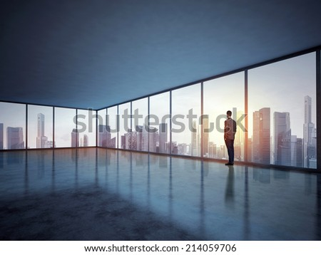 Business man looking megalopolis through window - stock photo