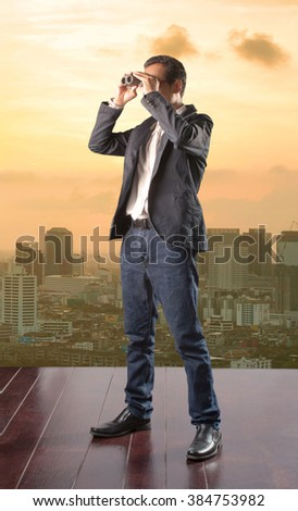 business man looking to future opportunity by binocular and using for spying in business strategy  - stock photo