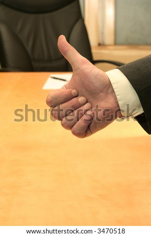 Business-man making an OK with his hand. - stock photo