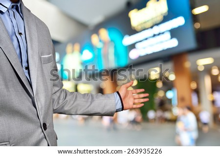 Business Man, Manager of Shopping Plaza or Mall, invite people to visit his Place as Retail Superstore or Department store service mind concept.  - stock photo