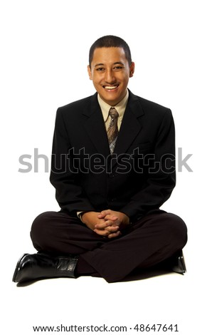 Business man meditating isolated on white background - stock photo