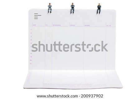 business man miniature figure sit down on passbooks concept idea to success white background with clipping path - stock photo
