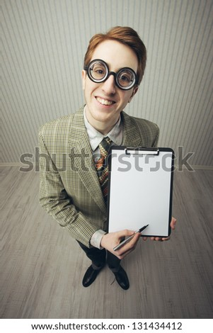 Business man nerd holds a blank sign, ready for your text, old style image - stock photo