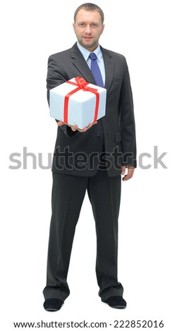 Business man offering a gift over a white background