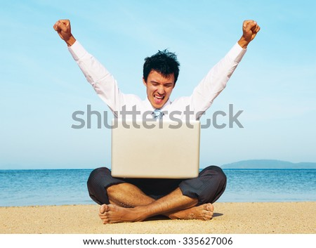 Business man on beach with laptop Concept - stock photo