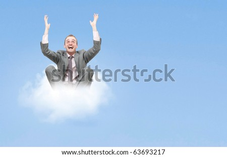 Business man on cloud - stock photo