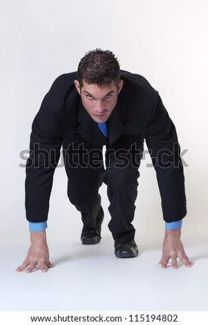 business man on the starting block - stock photo