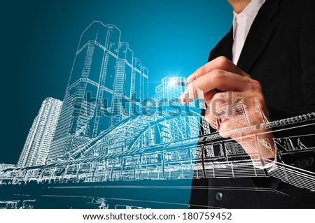 Business man or architect draw the drawing of building or cityscape - stock photo