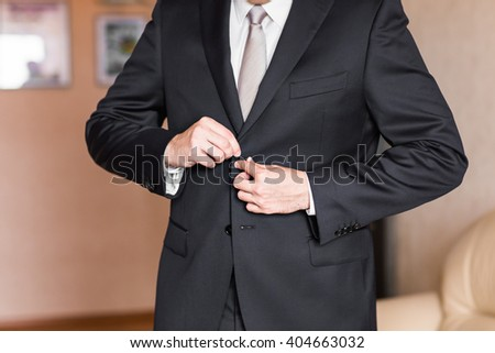 Business man or Groom wearing suit on wedding day and preparing.  - stock photo