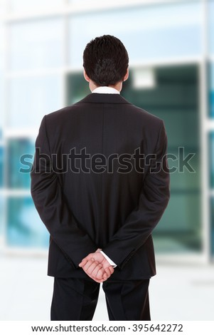 Business man outdoors over city background  - stock photo