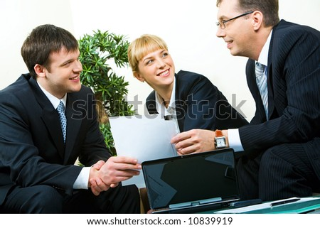 Business man passing the documents to his partner at meeting