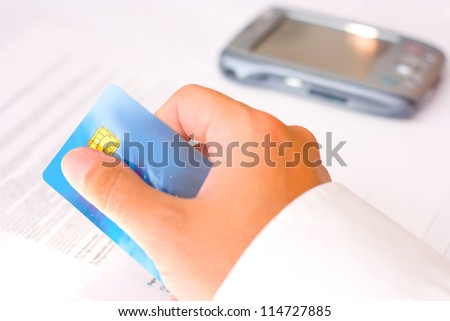 Business man paying with a credit card