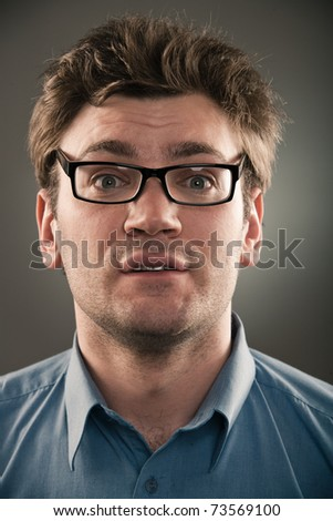 Business man person against gray background. One portrait  of a long series images of face with different emotions. - stock photo