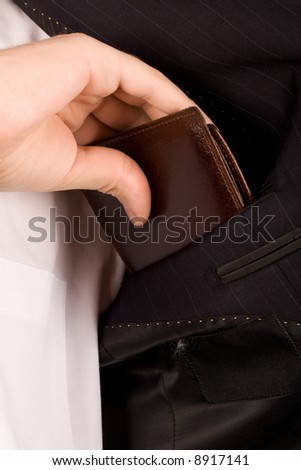 business man placing his wallet in pocket