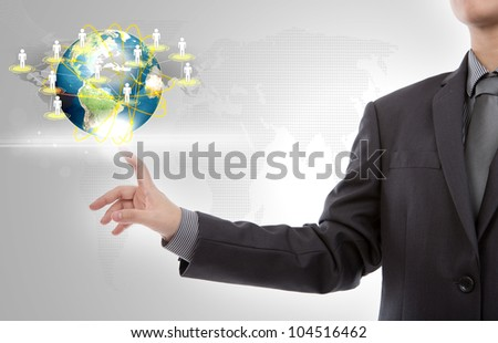 Business man point to earth of social network - stock photo
