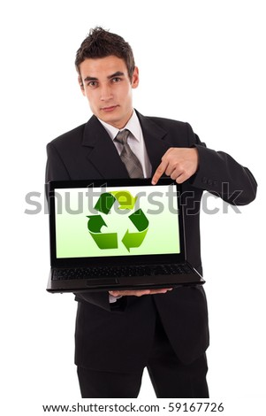 Business man pointing at a recycle sign in a laptop - stock photo