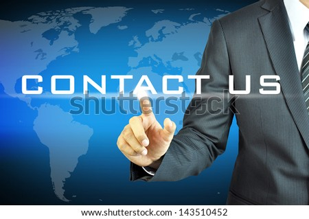 Business man pointing Contact Us sign - stock photo