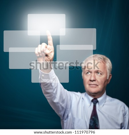 Business man pointing important things on big touch screen - stock photo