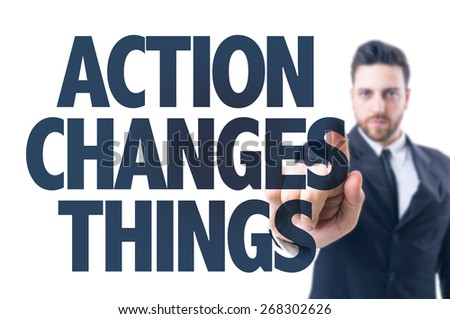 Business man pointing the text: Action Changes Things  - stock photo