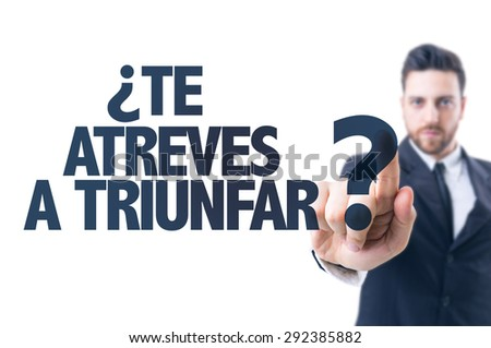 Business man pointing the text: Dare You To Success (in Spanish) - stock photo