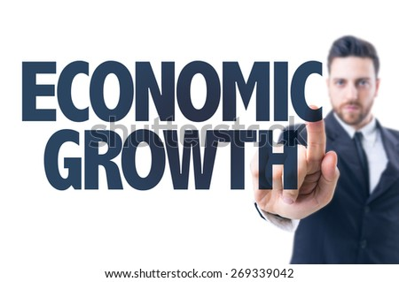 Business man pointing the text: Economic Growth - stock photo