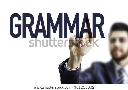 Business man pointing the text: Grammar - stock photo