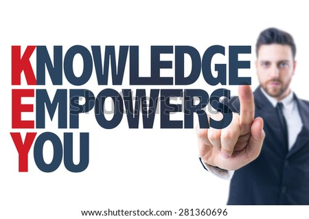 Business man pointing the text: Knowledge Empowers You - stock photo