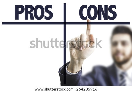 Business man pointing the text: Pros Cons - stock photo