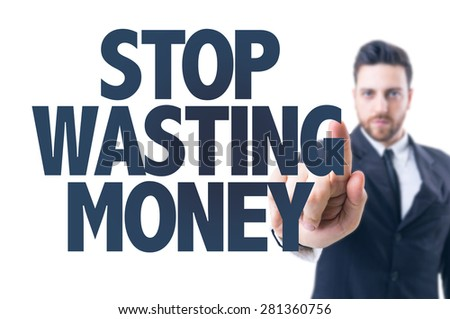 Business man pointing the text: Stop Wasting Money - stock photo