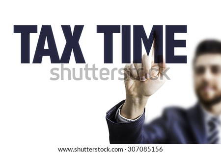 Business man pointing the text: Tax Time - stock photo