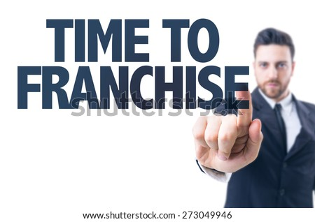 Business man pointing the text: Time to Franchise - stock photo