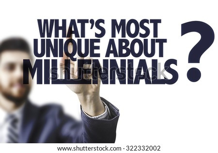 Business man pointing the text: Whats Most Unique About Millennials? - stock photo