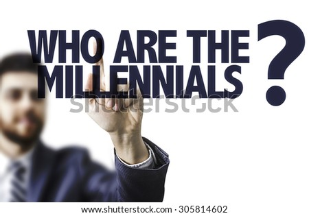 Business man pointing the text: Who Are The Millennials? - stock photo