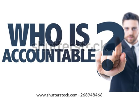 Business man pointing the text: Who Is Accountable? - stock photo