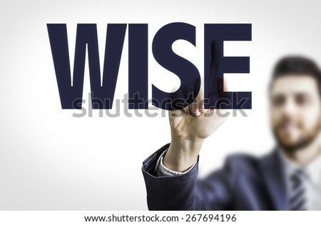 Business man pointing the text: Wise - stock photo