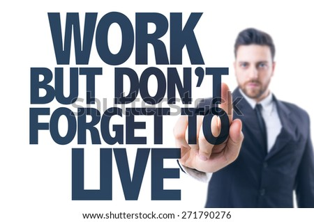 Business man pointing the text: Work But Don't Forget to Live - stock photo